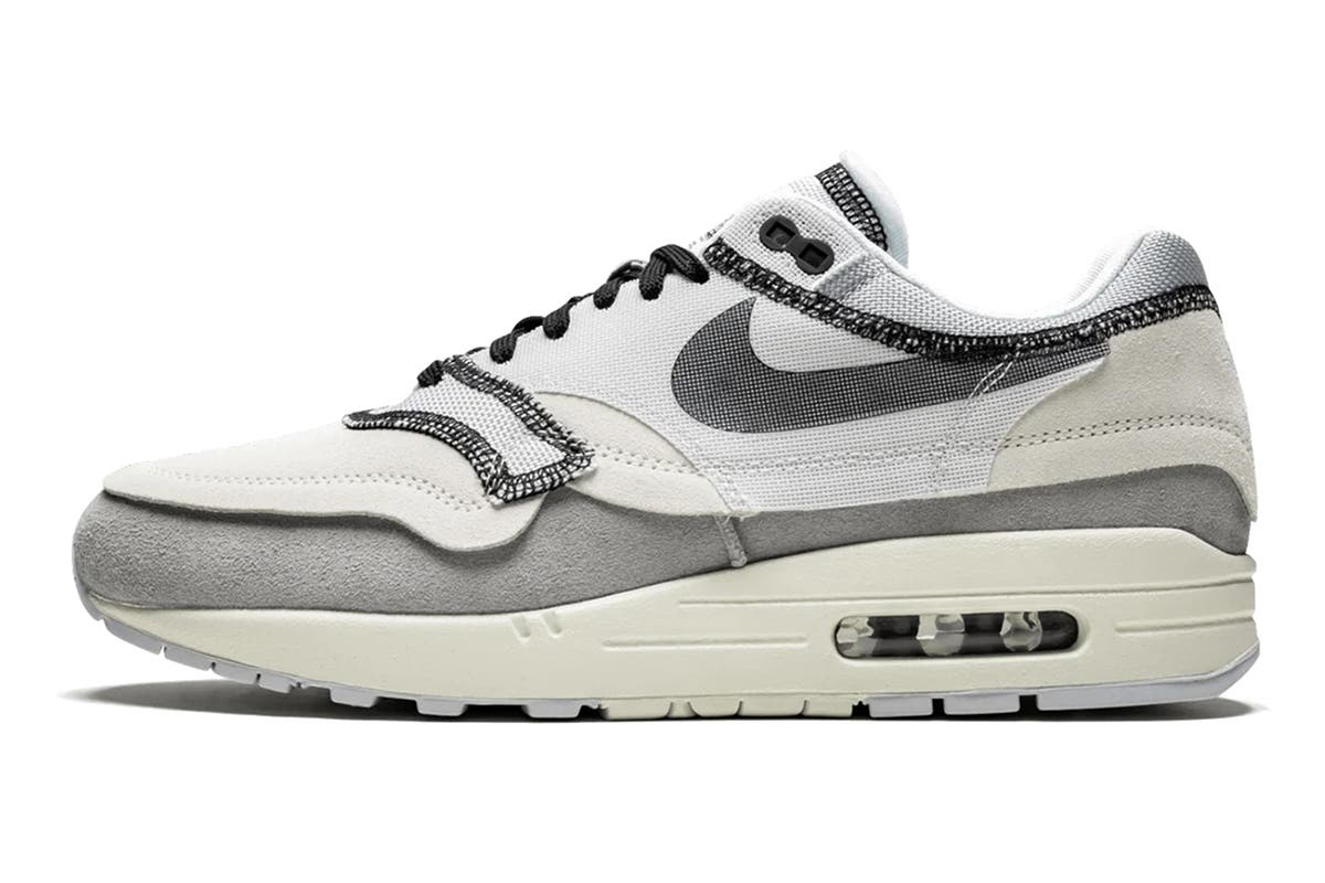 Nike Men's Air Max 1 Sneaker (Grey, Size 9 US) The Nike Men's Air Max 1 Sneakers are designed in such a way that their exposed stitching and unfinished edges make it look like the shoes have been reversed.   Textile upper Air Max cushioning Rubber outsole