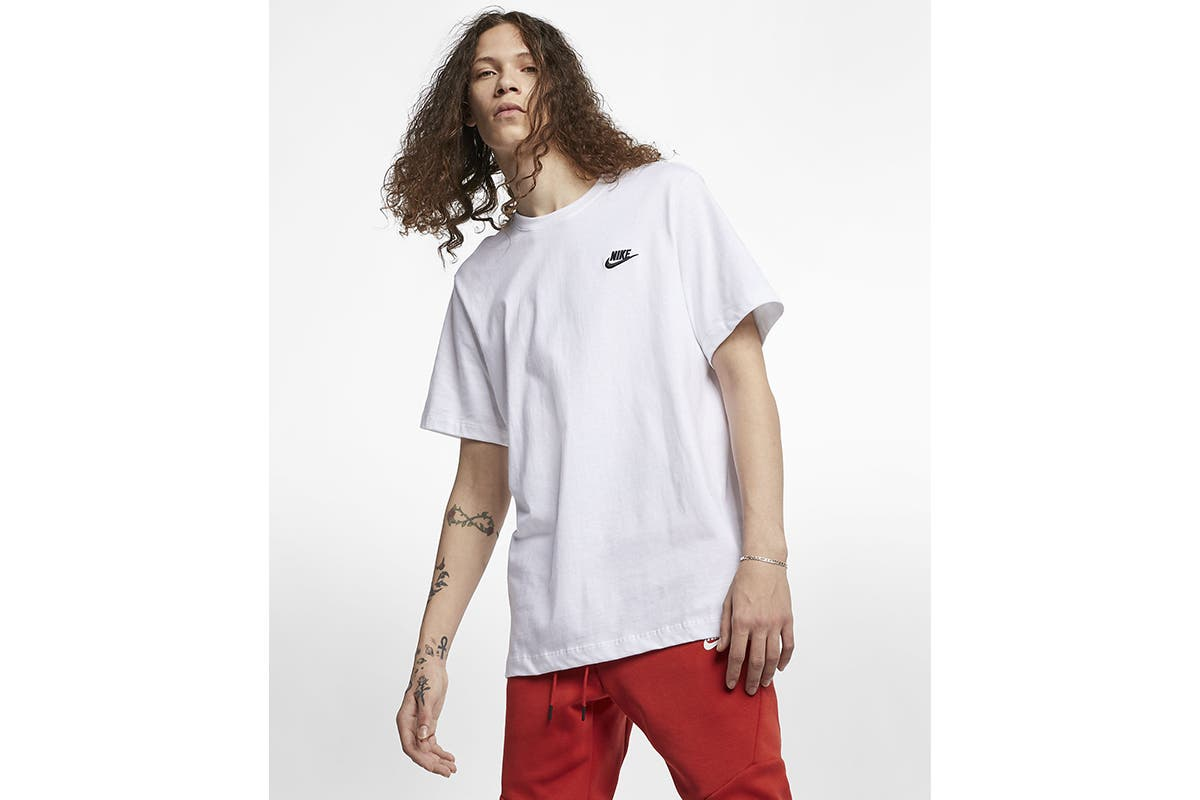 Nike Men's Club Tee (White/Black, Size XL) The Nike Men's Club Tee sets you up with soft cotton jersey and a classic logo embroidered on the chest.   100% cotton Standard fit for a relaxed, easy feel Machine washable
