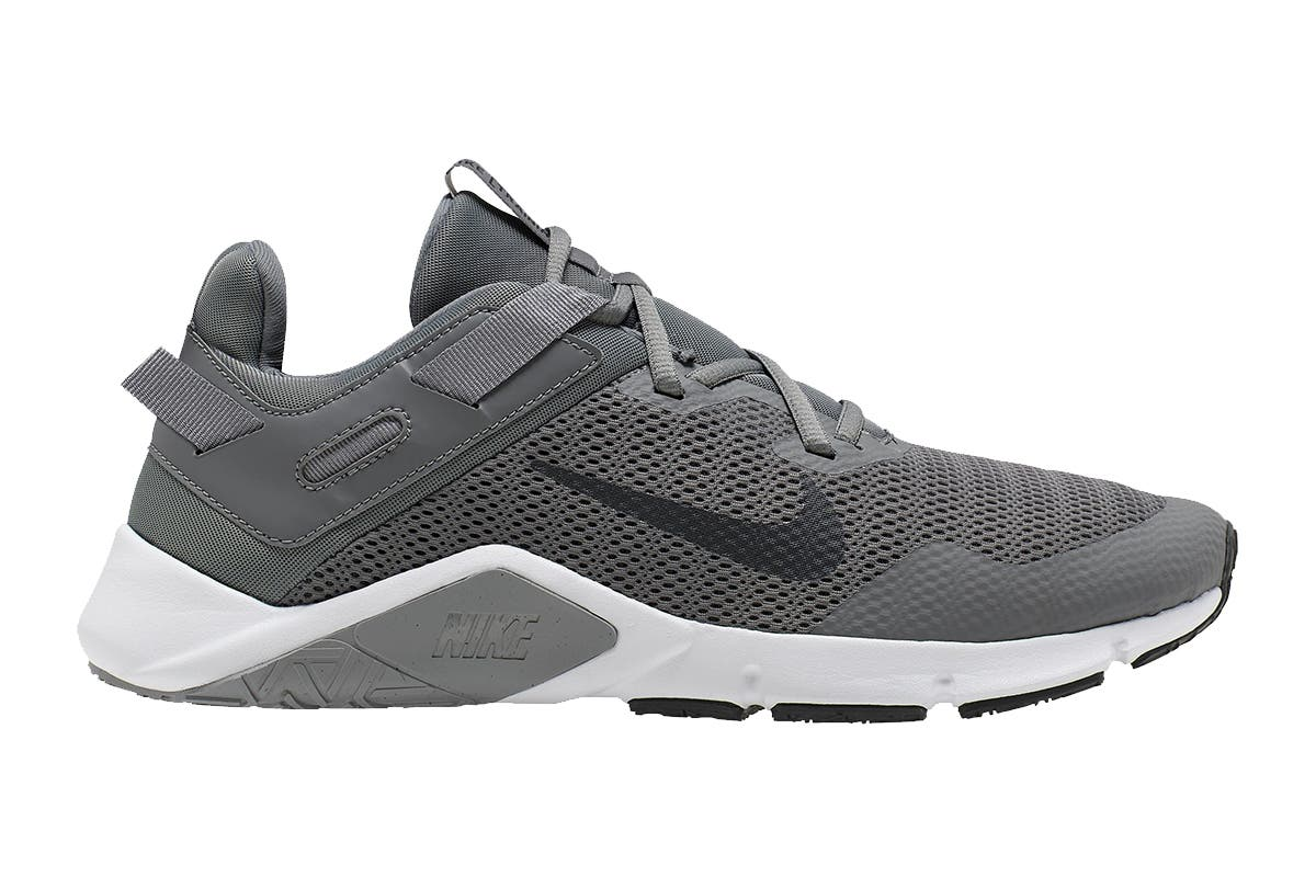 Nike Men's Nike Legend Essential Running Shoe (Grey/Dark Smoke Grey/White, Size 9 US) Nike Men's Nike Legend Essential Running Shoes are built with breathability and stability for weightlifting and strength-training workouts. The durable rubber tread in high-wear zones provides exceptional traction on all types of gym surfaces.   Abrasion-resistant upper for lasting wear Arch support on both sides Heel containment system locks back of foot in place Webbing lock adds extra stability Full-length rubber outsole with aggressive multi-directional traction pattern
