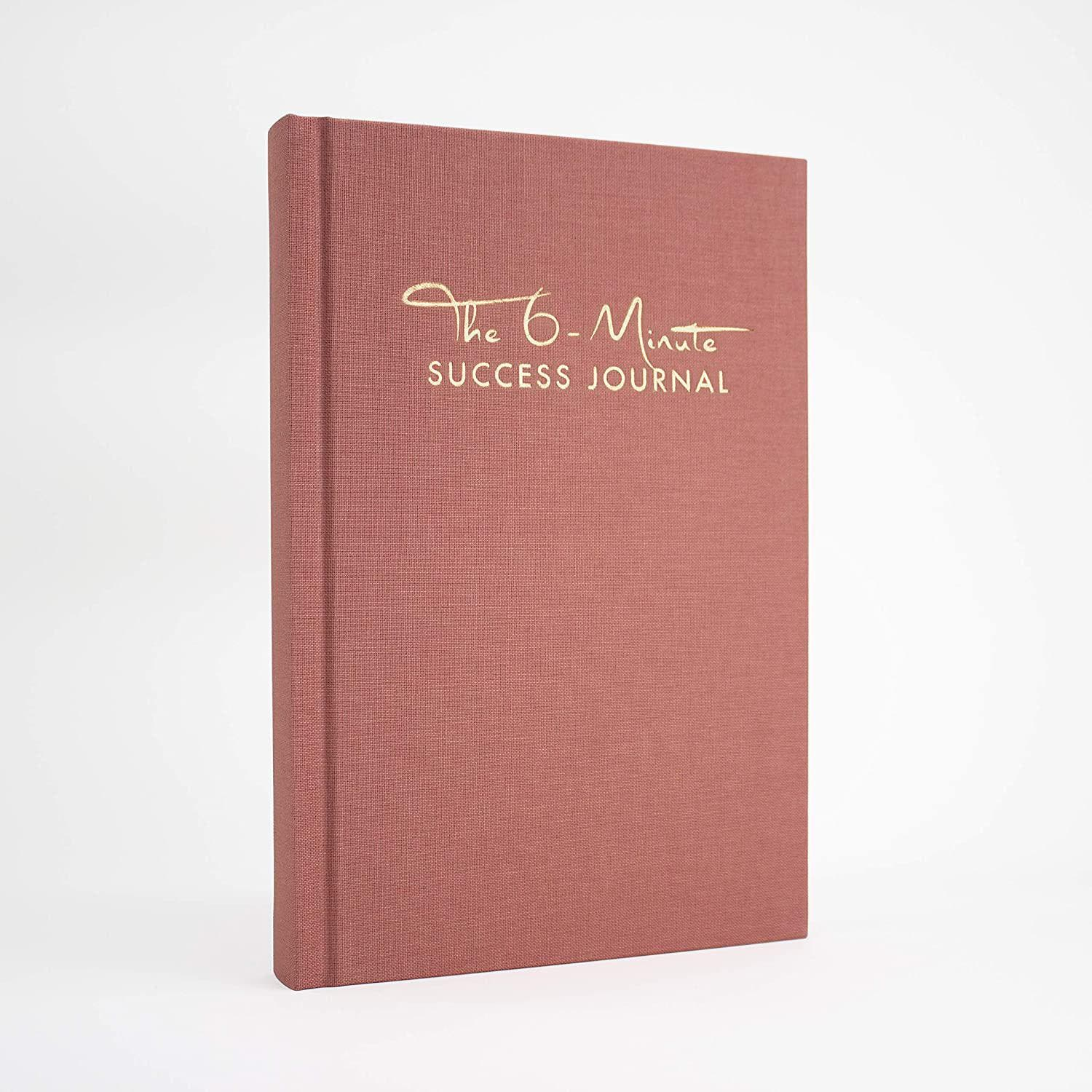 """The 6-Minute Success Journal   Reach Goals with More Focus and Calm   6 Minutes Daily for More Motivation, Success and Mindfulness   The Day Planner from The Makers of """"The 6-Minute Diary"""" Brand: UrBestSelfColor: Antique PinkFeatures:  ✅ BE PRODUCTIVE WITHOUT PRODUCING EXHAUSTION – By blending practice-proven mindfulness exercises with productivity boosting strategies, The 6 Minute-Success Journal stands out as a unique tool: it helps you pursue your big goals not only more consistently, but also more calmly. ✅ ACHIEVE GOALS THAT FULFILL YOUR LIFE – instead of just filling your schedule: By reflecting your innermost needs & values, you set meaningful goals. Live your own definition of personal and professional success! ✅ DO MORE WITH LESS – The concept is based on scientific findings and practice-proven techniques. This journal helps you to apply the proven 6-Minute Principle and to pursue your goals consistently and on a long-term basis – step by step, habit by habit. ✅ FOCUS ON WHAT'S IMPORTANT – The daily planner helps you to single out tasks that, upon completion, will maximise your benefit. By using this cleverly designed tool, you avoid falling prey to distractions and pursue your goals and visions instead. Say """"No"""" to chaos & hecticness and """"Yes"""" to more calm and clarity. ✅ HIGH QUALITY ON THE INSIDE AND OUTSIDE – Finest French linen, CO2-neutral print, vegan materials. Printed & bound with love in Germany. The success journal for everyone too busy for a success journal. Your companion for more fulfilment, focus and success. Details: PERSONAL GROWTH through REFLECTION:  Daily reflection is one of the key principles of The 6-Minute Diary. The Evening Routine and the Weekly 5 Questions are a unique tool to help you discover yourself and to set goals that align with who you truly are. The 6-Minute Diary will help you become the person you know you can be.   Discover what REALLY MAKES YOU HAPPY:  Research shows: When remembering what made us happy, we tend to add"""