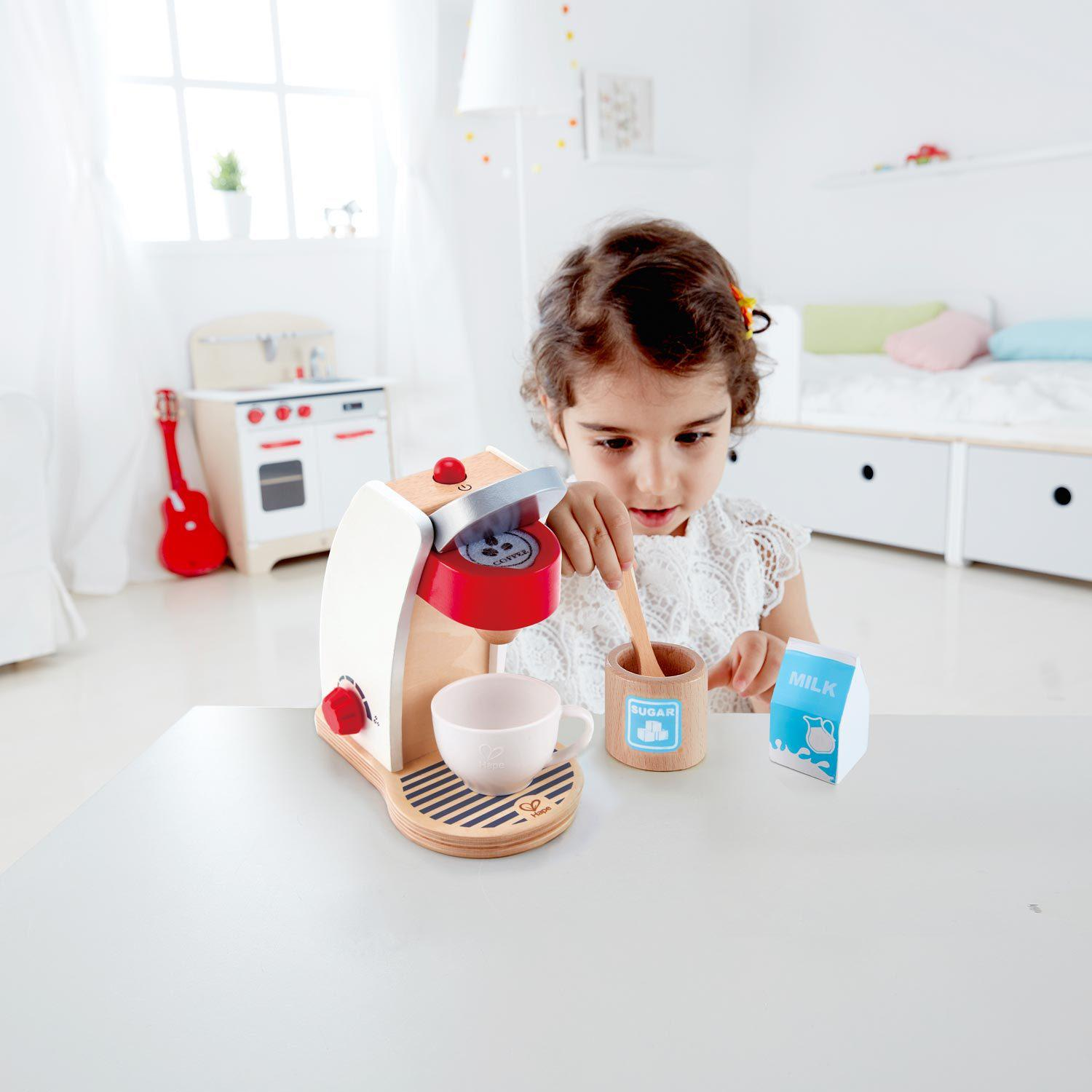 """Hape: My Coffee Machine """"Sitting back to relax with a cup of coffee is not just for adults, and with all you need to make a great cup of coffee, including, cup, milk, sugar, coffee pod and spoon, children will love the adjustable My Coffee Machine."""""""