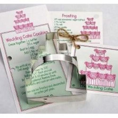 Ann Clark Wedding Cake Tin Cookie Cutter Ann Clark Wedding Cake Cookie Cutter : Tin cookie cutter in the shape of a WEDDING CAKE with sturdy tin handle and colourful recipe card. Each card includes a recipe for cookies and frosting.