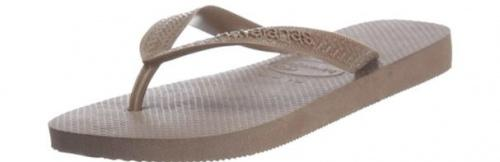 (5-6 UK, Dark Brown) - Havaianas Unisex Top Flip Flops Size: 5-6 UKColour: Dark Brown These Havaianas flip flops have the following features: The Havaianas Flip Flops Top are trendy light white flip flops for kids. Rubber foot sole with a rice grain pattern Rubber foot strap The text 'Havaianas' on the foot strap These flip flops are very comfortable. They are anti-slip and quickdry. Havaianas The brand Havaianas is founded is 1962. The design of the flip flops are inspired by the Zori, Japanese sandals. The rice grain pattern on those sandals are still used on the foot sole of the Havaianas. Flip flops have become part of the modern day culture. Tags: flip flops, flipflops.