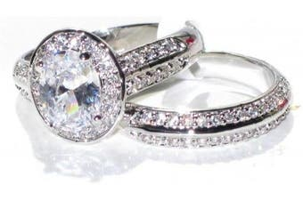 (S) - NEW IMPROVED! Never Tarnish 2.10ct Oval Cut World Class Lab Diamonds Engagement Wedding Set. 8.6mm Centre Stone Ring & Double Row Clear Crystal Matching Band. Stamped 316. Steel 4.8gr Total Weight.